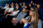 Group of people watching a 3D movie at the cinema